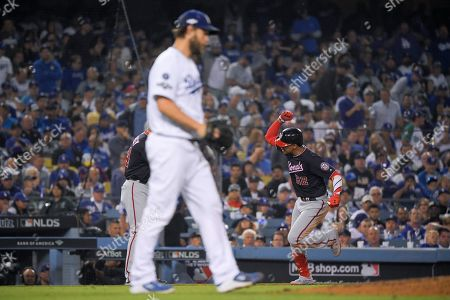 Washington Nationals' Juan Soto celebrates after a home run off Los Angeles Dodgers pitcher Clayton Kershaw during the eighth inning in Game 5 of a baseball National League Division Series, in Los Angeles