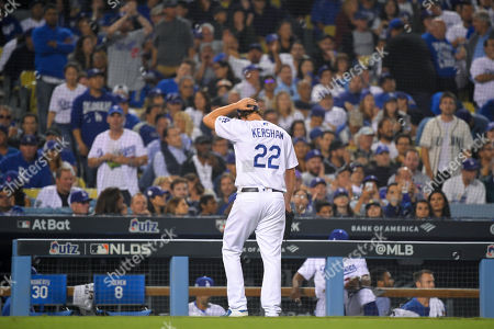 Los Angeles Dodgers pitcher Clayton Kershaw leaves after giving up back-to-back home runs to the Washington Nationals during the eighth inning in Game 5 of a baseball National League Division Series, in Los Angeles