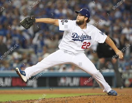 Los Angeles Dodgers pitcher Clayton Kershaw winds up for a pitch in relief against Washington Nationals Adam Eaton in the top of the seventh inning of the MLB National League Division Series playoff baseball game five between the Washington Nationals and the Los Angeles Dodgers at Dodgers Stadium in Los Angeles, California, USA, 09 October 2019.