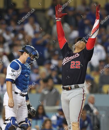 Stock Picture of Washington Nationals left fielder Juan Soto (R) of the Dominican Republic celebrates while crossing home plate after hitting a solo home run off Los Angeles Dodgers relief pitcher Clayton Kershaw to tie the score as Los Angeles Dodgers catcher Will Smith (L) looks away in the of top of eighth  inning of the MLB National League Division Series playoff baseball game five between the Washington Nationals and the Los Angeles Dodgers at Dodgers Stadium in Los Angeles, California, USA, 09 October 2019.