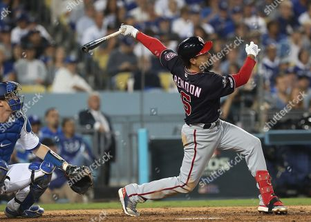 Washington Nationals Anthony Rendon (R) follows through with a solo home run off Los Angeles Dodgers relief pitcher Clayton Kershaw as Los Angeles Dodgers catcher Will Smith (L) looks on in the top of the eighth inning of the MLB National League Division Series playoff baseball game five between the Washington Nationals and the Los Angeles Dodgers at Dodgers Stadium in Los Angeles, California, USA, 09 October 2019.