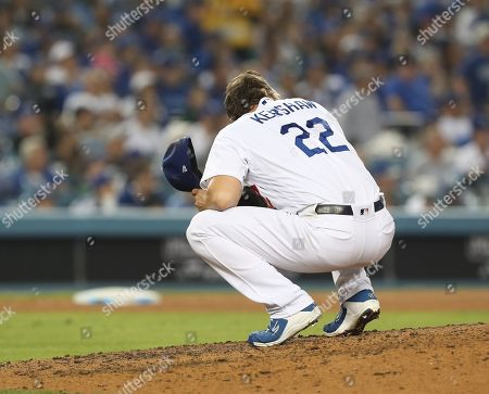 Los Angeles Dodgers relief pitcher Clayton Kershaw reacts on the mound after giving up a game tying home run to Washington Nationals Juan Soto in the top of the eighth inning of the MLB National League Division Series playoff baseball game five between the Washington Nationals and the Los Angeles Dodgers at Dodgers Stadium in Los Angeles, California, USA, 09 October 2019.