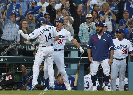 Stock Image of Los Angeles Dodgers left fielder Enrique (Kike) Hernandez (L) of Puerto Rico is greeted by Los Angeles Dodgers right fielder Joc Pederson (2-L) after hitting a solo home run off Washington Nationals starting pitcher Stephen Strasburg in the bottom of the second inning of the MLB National League Division Series playoff baseball game five between the Washington Nationals and the Los Angeles Dodgers at Dodgers Stadium in Los Angeles, California, USA, 09 October 2019.