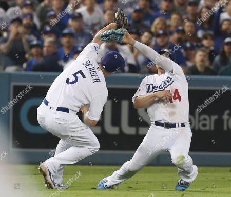 Los Angeles Dodgers shortstop Corey Seager (L) is unable to make hold onto a catch while avoiding a collision with Los Angeles Dodgers second baseman Enrique Hernandez (R) of Puerto Rico as Washington Nationals Juan Soto reaches on base by the fielding error by Seager in the top of the fourth inning of the MLB National League Division Series playoff baseball game five between the Washington Nationals and the Los Angeles Dodgers at Dodgers Stadium in Los Angeles, California, USA, 09 October 2019.