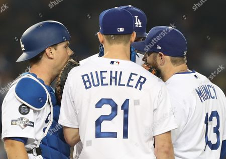 Los Angeles Dodgers starting pitcher Walker Buehler (C), Los Angeles Dodgers catcher Will Smith (L), Los Angeles Dodgers first baseman Max Muncy (R), and Los Angeles Dodgers shortstop Corey Seager (background) have a mound talk before Washington Nationals Adam Eaton comes up to bat in the top of the fifth inning of the MLB National League Division Series playoff baseball game five between the Washington Nationals and the Los Angeles Dodgers at Dodgers Stadium in Los Angeles, California, USA, 09 October 2019.