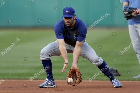 Los Angeles Dodgers left fielder Chris Taylor works out prior to Game 4 of a baseball National League Division Series against the Washington Nationals, in Washington