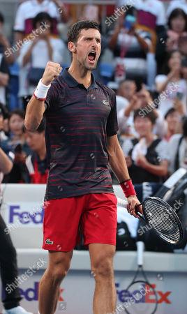 Novak Djokovic of Serbia shouts as he defeated David Goffin of Belgium during the Men's Singles Semi-final