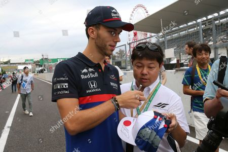 Toro Rosso driver Pierre Gasly of France signs his autograph after a fan meeting at the Suzuka Circuit in Suzuka, central Japan, ahead of the Japanese Formula One Grand Prix