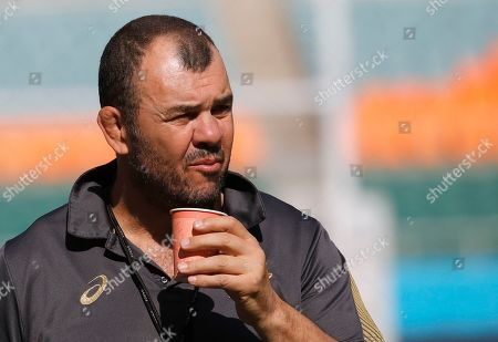 Australia rugby coach Michael Cheika drinks during a training session at Shizuoka Stadium Ecopa, Japan, . Australia will play tomorrow against Georgia during their Rugby World Cup Pool D game