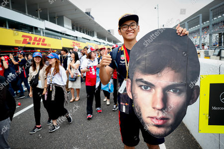 A Japanese Formula 1 fan supporting French Formula One driver Pierre Gasly of Scuderia Toro Rosso poses on the pitlane at the Suzuka circuit ahead of the Japanese Formula One Grand Prix in Suzuka, Japan, 10 October 2019. The Japanese Formula One Grand Prix will take place on 13 October 2019.