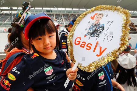 A young Japanese Formula 1 fan supporting French Formula One driver Pierre Gasly of Scuderia Toro Rosso poses along the pitlane at the Suzuka circuit ahead of the Japanese Formula One Grand Prix in Suzuka, Japan, 10 October 2019. The Japanese Formula One Grand Prix will take place on 13 October 2019.