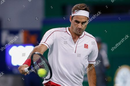 Roger Federer of Switzerland hits a return shot against David Goffin of Belgium during their men's singles match at the Shanghai Masters tennis tournament at Qizhong Forest Sports City Tennis Center in Shanghai, China