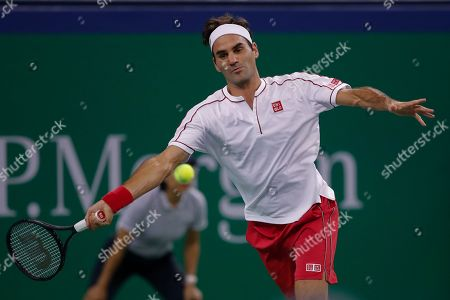 Roger Federer of Switzerland prepares to hit a return shot against David Goffin of Belgium during their men's singles match at the Shanghai Masters tennis tournament at Qizhong Forest Sports City Tennis Center in Shanghai, China
