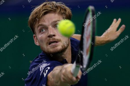 David Goffin of Belgium hits a return shot against Roger Federer of Switzerland during their men's singles match at the Shanghai Masters tennis tournament at Qizhong Forest Sports City Tennis Center in Shanghai, China