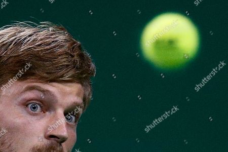 David Goffin of Belgium eyes on the ball as he plays against Roger Federer of Switzerland during their men's singles match at the Shanghai Masters tennis tournament at Qizhong Forest Sports City Tennis Center in Shanghai, China