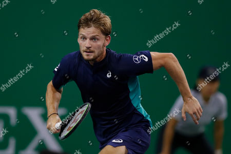 David Goffin of Belgium runs as he plays against Roger Federer of Switzerland during their men's singles match at the Shanghai Masters tennis tournament at Qizhong Forest Sports City Tennis Center in Shanghai, China