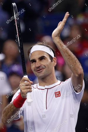 Roger Federer of Switzerland gestures to spectators after defeating David Goffin of Belgium in their men's singles match at the Shanghai Masters tennis tournament at Qizhong Forest Sports City Tennis Center in Shanghai, China