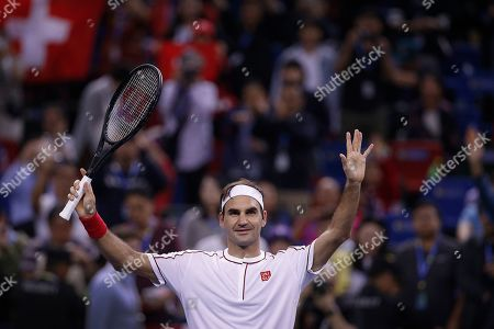 Roger Federer of Switzerland celebrates after defeating David Goffin of Belgium in their men's singles match at the Shanghai Masters tennis tournament at Qizhong Forest Sports City Tennis Center in Shanghai, China
