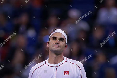 Stock Image of Roger Federer of Switzerland reacts during the men's singles match against David Goffin of Belgium at the Shanghai Masters tennis tournament at Qizhong Forest Sports City Tennis Center in Shanghai, China