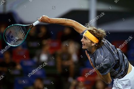 Alexander Zverev of Germany serves against Andrey Rublev of Russia during the men's singles match at the Shanghai Masters tennis tournament at Qizhong Forest Sports City Tennis Center in Shanghai, China