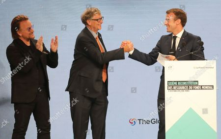 From left to right, U2 singer Bono, Philanthropist Philanthropist and Co-Chairman of the Bill & Melinda Gates Foundation Bill Gates and France's President Emmanuel Macron congratulate each other on stage during the Global Fund to Fight AIDS event at the Lyon's congress hall, central France, . French President Emmanuel Macron said the conference of the Global Fund to fight against AIDS, tuberculosis and malaria raised at least $13.92 billion for the next three years