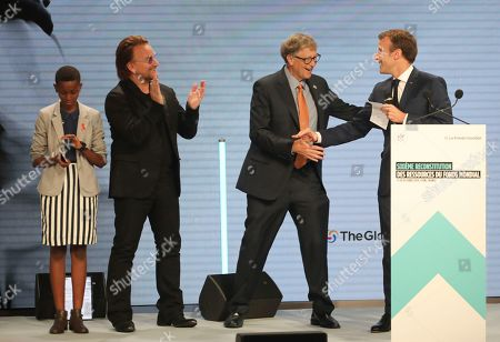 """From left to right, goodwill ambassador of the ONG """"Grandir Ensemble"""" Amanda Dushime, U2 singer Bono, Philanthropist Philanthropist and Co-Chairman of the Bill & Melinda Gates Foundation Bill Gates and France's President Emmanuel Macron congratulate each other on stage during the Global Fund to Fight AIDS event at the Lyon's congress hall, central France, . French President Emmanuel Macron said the conference of the Global Fund to fight against AIDS, tuberculosis and malaria raised at least $13.92 billion for the next three years"""