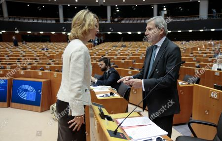 Finland's Minister for European Affairs Tytti Tuppurainen (L) and Johannes Hahn (R), European Commissioner-designate for Budget and Administration, during a second day of a plenary session at the European Parliament in Brussels, Belgium, 10 October 2019. The Multiannual Financial Framework 2021-2027 is the main topic of the session.