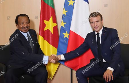 Stock Image of Cameroon President Paul Biya (L) and France's President Emmanuel Macron (R) shake hands prior to bilateral talks in Lyon, France, 10 OCtober 2019, during the meeting of international lawmakers, health leaders and people affected by HIV, Tuberculosis and malaria.  Lyon is hosting the two day Global Fund event aimed at raising money to help in the global fight against the epidemics.