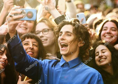 Timothee Chalamet takes a selfie with fans as he arrives for the Australian premiere of the movie 'The King' at The Ritz Cinema in Randwick, Sydney, Australia, 10 October 2019.