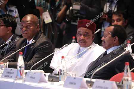Stock Picture of (L-R) Central African Republic President Faustin-Archange Touadera, Niger President Mahamadou Issoufou, and Cameroon President Paul Biya listen to the opening speech at the World Fund opening session in Lyon, France, 10 October. The Sixth Global Fund to Fight AIDS, Tuberculosis and Malaria on 09 October opened a drive to raise 14 billion US dollar to fight a global epidemics but face an uphill battle in the face of donor fatigue.