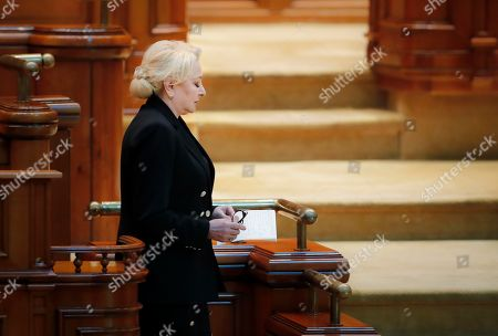 Romanian Prime Minister Viorica Dancila leaves after closing remarks during a no confidence vote in Bucharest, Romania, . Romania's Social Democrat government has lost a vote of no-confidence in Parliament