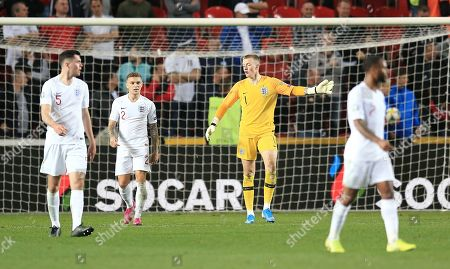 Jordan Pickford of England reacts after conceding 2nd goal