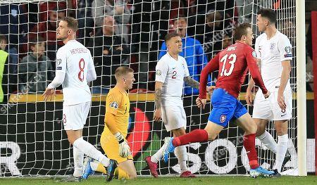 Jordan Pickford ,Kieran Trippier and Jordan Henderson of England react after conceding 2nd goal