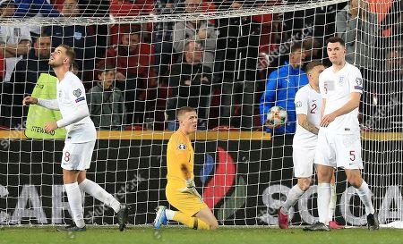 Jordan Pickford ,Jordan Henderson and Michael Keane of England  react after conceding 2nd goal