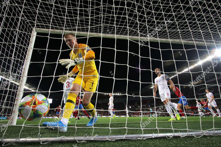 Jordan Pickford of England gathers the ball from goal netting after conceding 1st goal