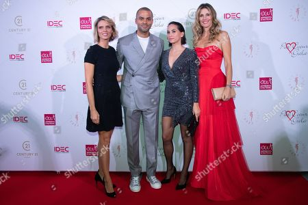 Stock Photo of Tony Parker and his wife Axelle Francine with Sylvie Tellier and Sophie Thalmann