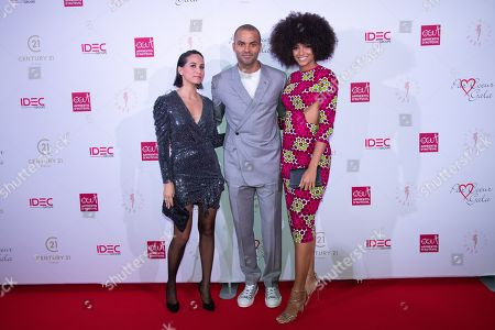 Tony Parker and his wife Axelle Francine with Alicia Aylies.
