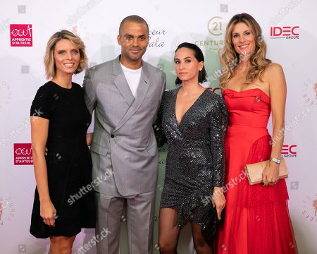 Stock Picture of Tony Parker and his wife Axelle Francine with Sylvie Tellier and Sophie Thalmann