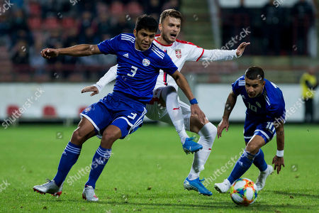 Adem Ljajic of Serbia competes against  Miguel Almiron of Paraguay and Derlis Gonz?lez Galeano of Paraguay
