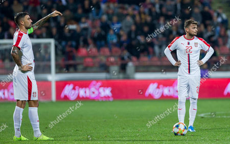 Adem Ljajic of Serbia and Aleksandar Kolarov prepare to perform the free kick