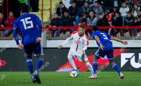 Adem Ljajic of Serbia takes on Robert Rojas of Paraguay
