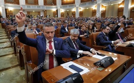 Romanian lawmakers of both parliament chambers start the voting procedures for the schedule of a no-confidence vote against Viorica Dancila's cabinet, at Parliament Palace in Bucharest, Romania, 10 October 2019. The opposition parties pushed a no-confidence vote against the ruling coalition after the junior partner of the  ruling coalition, ALDE party, pulled out of the government in August, leaving the senior PSD party without a majority. For the no-confidence vote to pass, it needs the support of 233  lawmakers from the total number of 465.