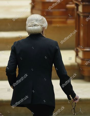 Romania's Prime Minister Viorica Dancila heads to her chair after addressing  the lawmakers of both parliament chambers as she faces a no-confidence vote, at Parliament Palace in Bucharest, Romania, 10 October 2019. The opposition parties pushed a no-confidence vote against the ruling coalition after the junior partner of the  ruling coalition, ALDE party, pulled out of the government in August, leaving the senior PSD party without a majority. For the no-confidence vote to pass, it needs the support of 233  lawmakers from the total number of 465.