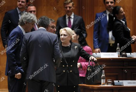Romania's Prime Minister Viorica Dancila(C), backed by her cabinet members, arrives for the no-confidence procedure at Parliament Palace in Bucharest, Romania, 10 October 2019. The opposition parties pushed a no-confidence vote against the ruling coalition after the junior partner of the  ruling coalition, ALDE party, pulled out of the government in August, leaving the senior PSD party without a majority. For the no-confidence vote to pass, it needs the support of 233  lawmakers from the total number of 465.