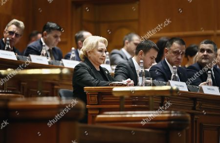 Romania's Prime Minister Viorica Dancila (C) watch the scene before to address the lawmakers of both parliament chambers as she faces a no-confidence vote, at Parliament Palace in Bucharest, Romania, 10 October 2019. The opposition parties pushed a no-confidence vote against the ruling coalition after the junior partner of the  ruling coalition, ALDE party, pulled out of the government in August, leaving the senior PSD party without a majority. For the no-confidence vote to pass, it needs the support of 233  lawmakers from the total number of 465.