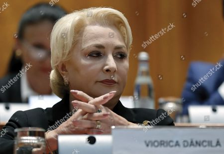 Romania's Prime Minister Viorica Dancila prepares to address the lawmakers of both parliament chambers as she faces a no-confidence vote, at Parliament Palace in Bucharest, Romania, 10 October 2019. The opposition parties pushed a no-confidence vote against the ruling coalition after the junior partner of the  ruling coalition, ALDE party, pulled out of the government in August, leaving the senior PSD party without a majority. For the no-confidence vote to pass, it needs the support of 233  lawmakers from the total number of 465.