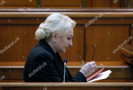 Romania's Prime Minister Viorica Dancila leaves the stage after addressing the lawmakers of both parliament chambers as she faces a no-confidence vote, at Parliament Palace in Bucharest, Romania, 10 October 2019. The opposition parties pushed a no-confidence vote against the ruling coalition after the junior partner of the  ruling coalition, ALDE party, pulled out of the government in August, leaving the senior PSD party without a majority. For the no-confidence vote to pass, it needs the support of 233  lawmakers from the total number of 465.