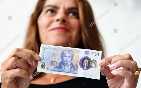 British and Margate based artist Tracey Emin holds the new 20 pound note during an unveiling with Bank of England Governor Mark Carney at the Turner Contemporary Museum in Margate, Britain, 10 October 2019.