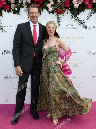 Stock Photo of Former Australian Cricketer and Founder of the McGrath Foundation Glenn McGrath and wife Sara Leonardi pose for a photograph during the inaugural Everest Carnival Fashion Lunch at Royal Randwick Racecourse in Sydney, Australia, 10 October 2019.
