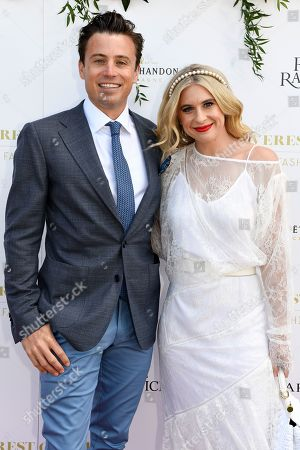 Australian TV personality James Tobin and Channel Seven racing and sports presenter Emma Vosti pose for a photograph during the inaugural Everest Carnival Fashion Lunch at Royal Randwick Racecourse in Sydney, Australia, 10 October 2019.